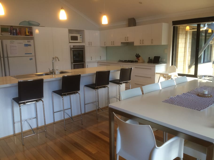 Open plan kitchen, dining and family room.  Kitchen has dishwasher, two fridges, microwave and double oven.  Family room table seats 10 people.