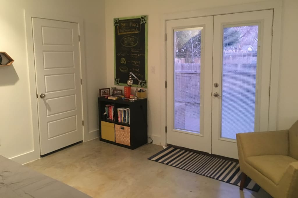 The French door in the bedroom opens up into the wooden patio in the backyard. The room comes with an attached bathroom.