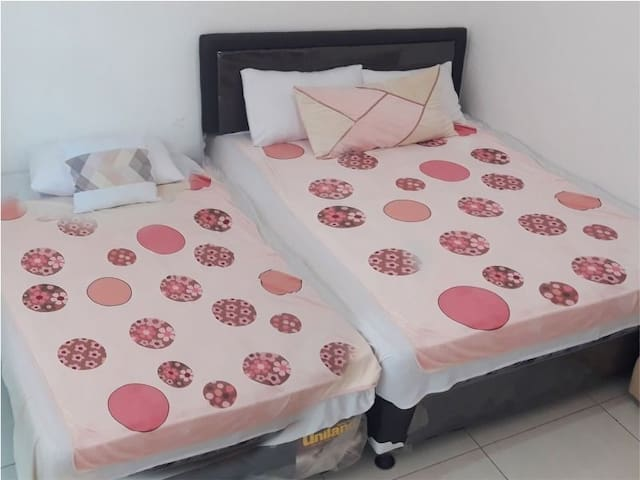 Room with Ac. 1 king bed & 1 single bed