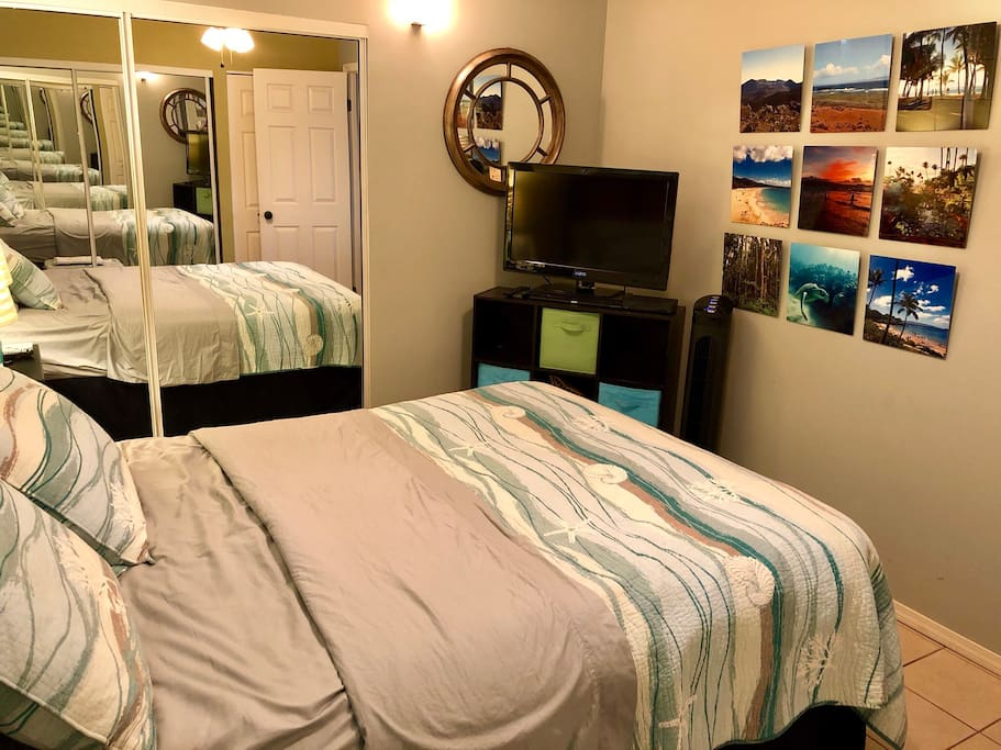 Hawaiian themed bedroom with a metal print collage of photos I took on Maui.