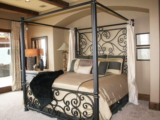 Serengeti Suite with king bed, panoramic Lake Travis views, private bath, and direct access to pool deck.