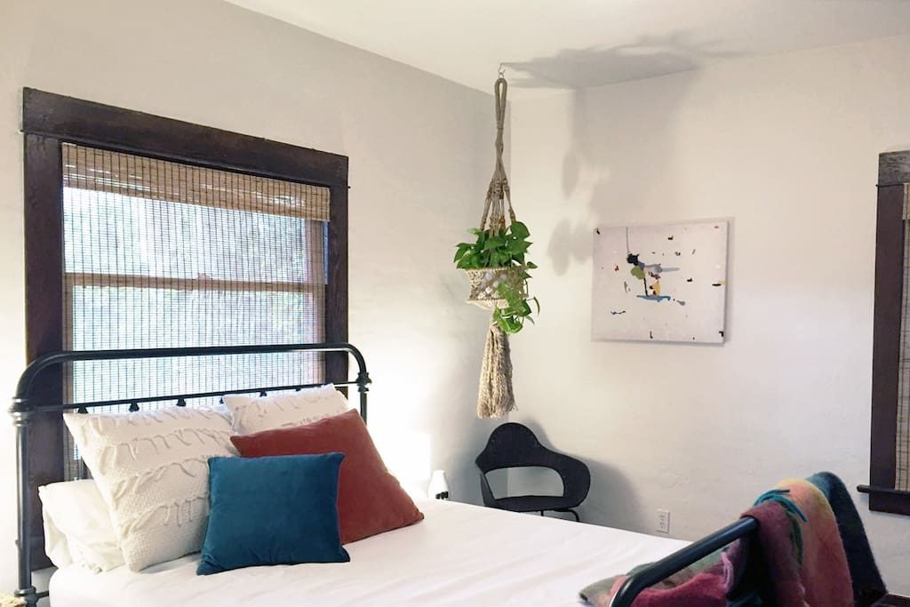 Your cozy bedroom with comfy queen bed, fine art, and bohemian botanicals!