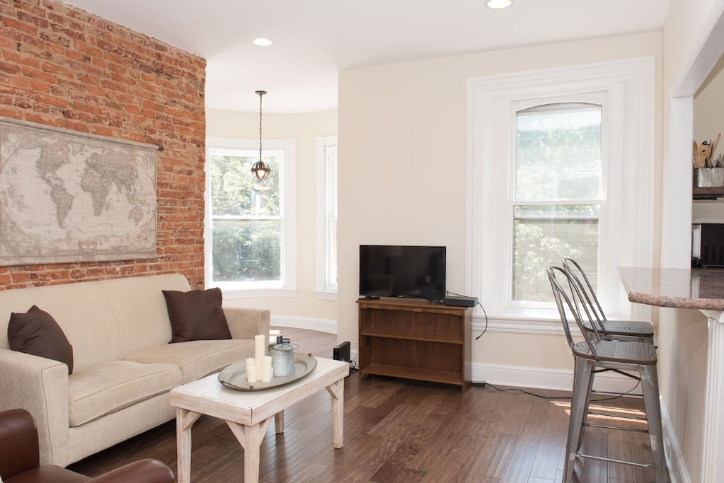 Exposed brick, natural light and open living space make this unit a comfortable and an easy place to stay.