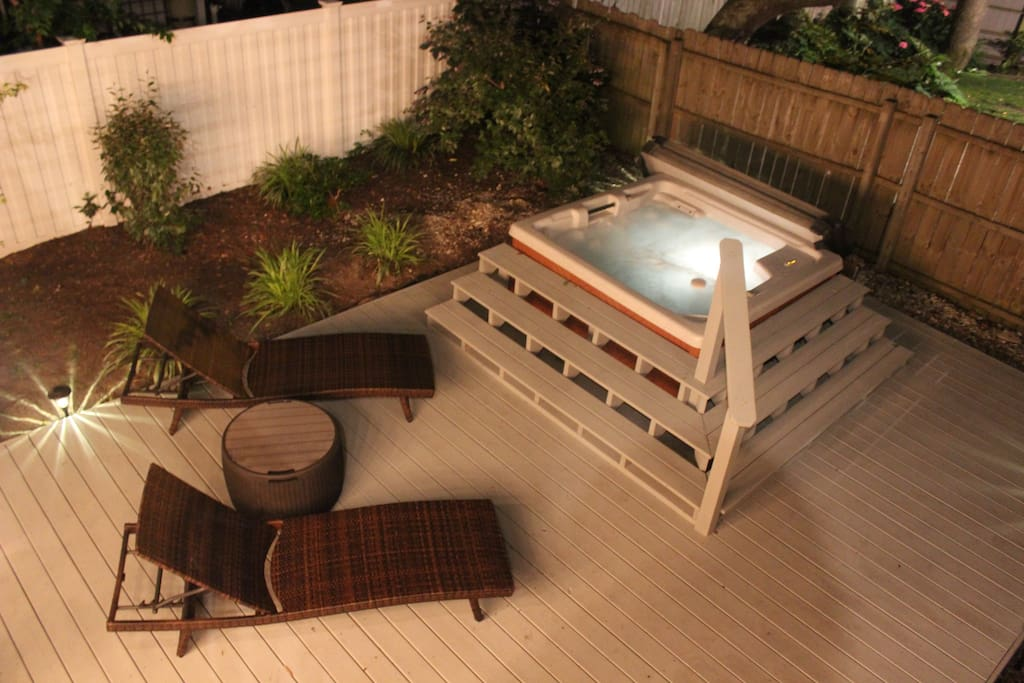 With a brand new oversized deck and hot tub for 4, you'll have a hard time choosing between the beach or the back yard