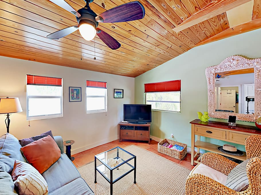 The living room boasts a flat screen TV and cheery furnishings. Complimentary Wi-Fi is provided.