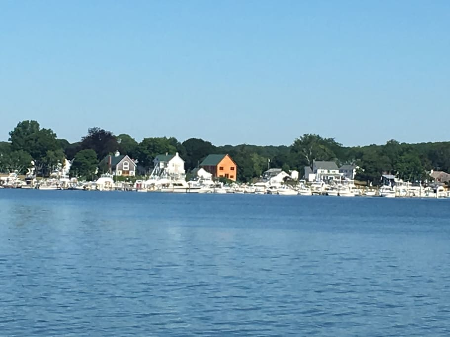 My house is across the street from the unfinished structure. You can see the river from the bedroom balcony. To the left is the Long Island sound. Feel free to use the paddle boards.