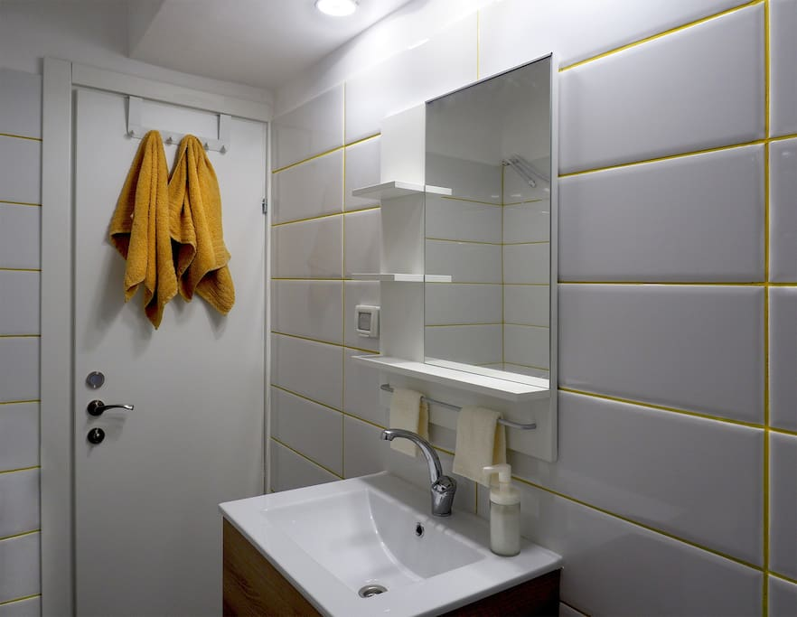 Bright and brand new bathroom with a large shower