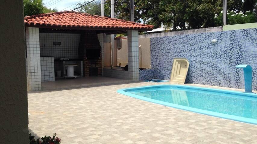 Casa Guarajuba condomínio água, 4/4, piscina.
