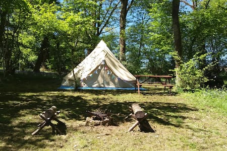 Luxury 5m bell tent in a quiet woodland setting
