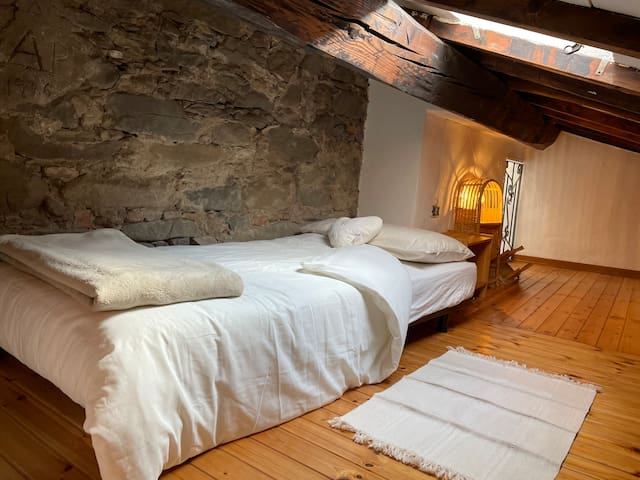 One of the two twin beds on the mezzanine