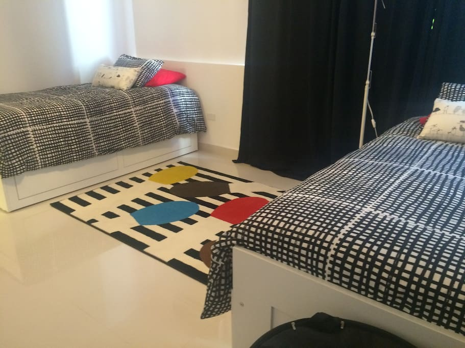 Spacious two bedroom with additional sleeping space below each bed.
