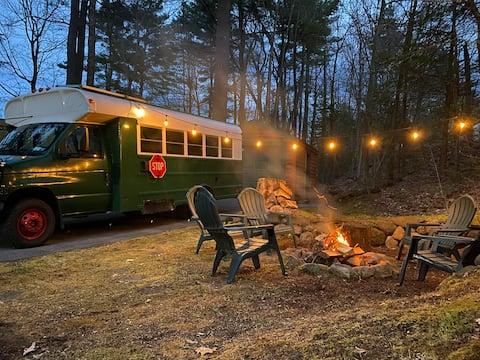 Stay in a log cabin, hang in a school bus