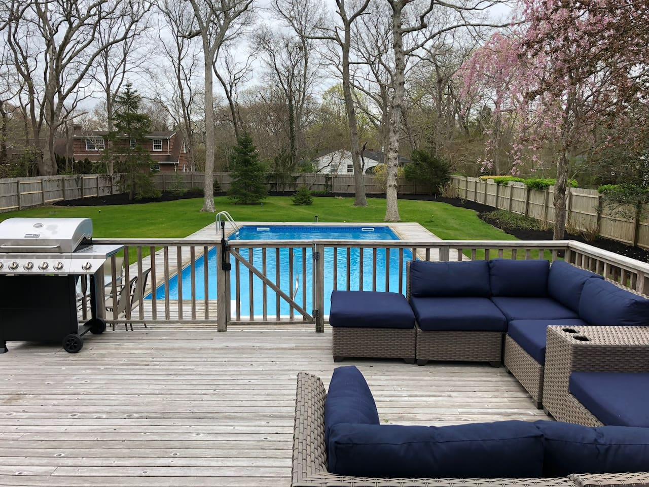 Gas BBQ, outdoor sectional seating, pool lounges and dining table with umbrella.  Newly landscaped yard with outdoor lighting for evening enjoyment and lighted extra-large pool for night swimming