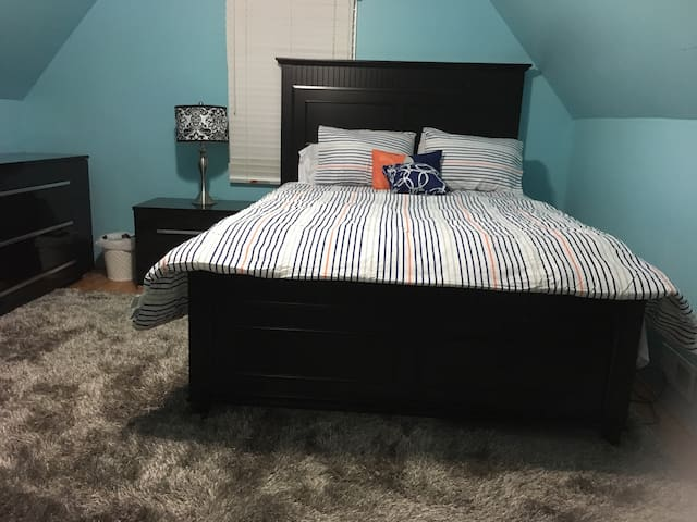 Another view of the queen size bed in the blue bedroom.