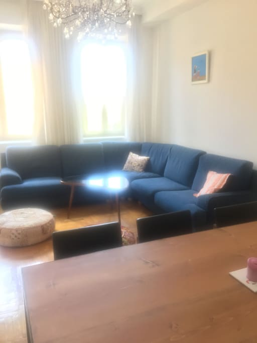 2nd living room with dining table and large sofa