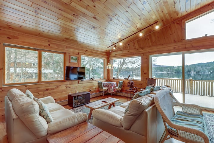 Lakefront, two-story Adirondack log cabin with dock and sandy beach