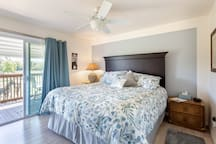 Master bedroom features a comfy king size bed, walk-in closet with  2 chests, flat screen TV, and a gorgeous, covered deck.....overlooking 6 verdant pastures with horses.