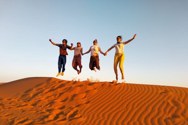 My son Rachid with our guests exploring the sand dunes