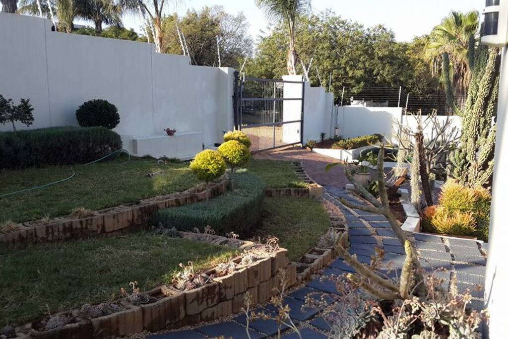 Garden view from room - note security gates and electrical fence