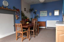 The dining table extends for social mealtimes.