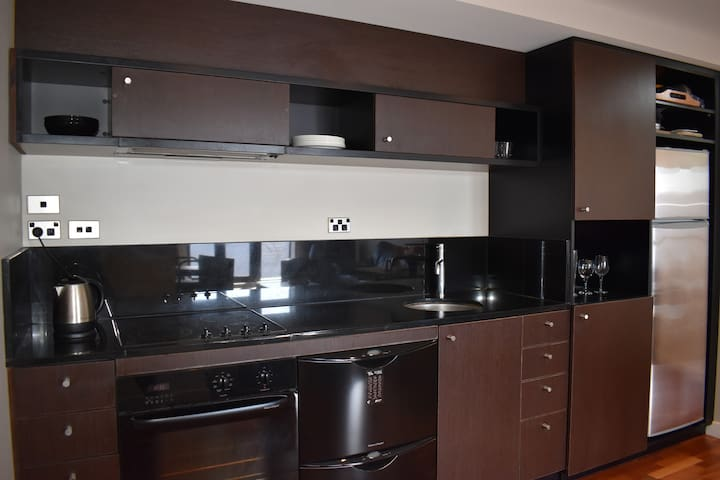 The apartment features a well equipped kitchen