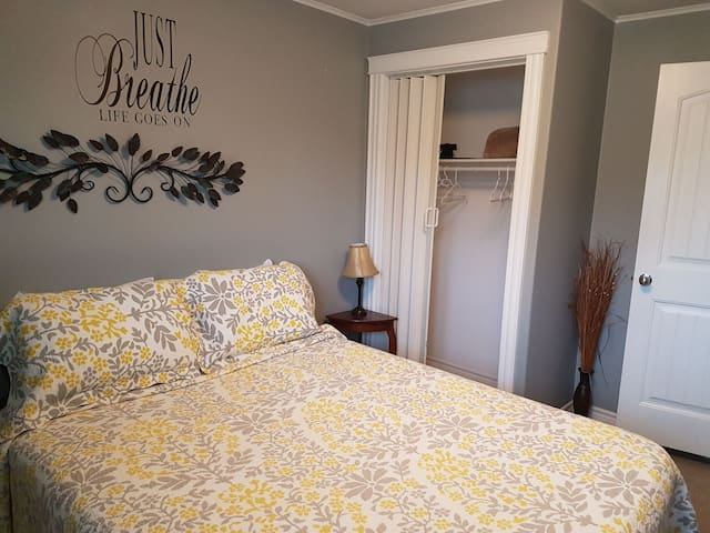 Bedroom with closet and hangers