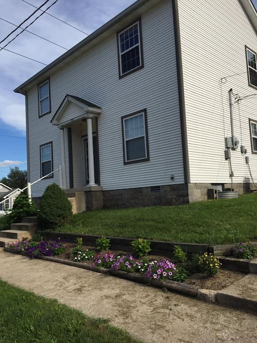 My humble abode. I put in this flower garden over the summer and hope to expand it because I don't like to Mow. :)