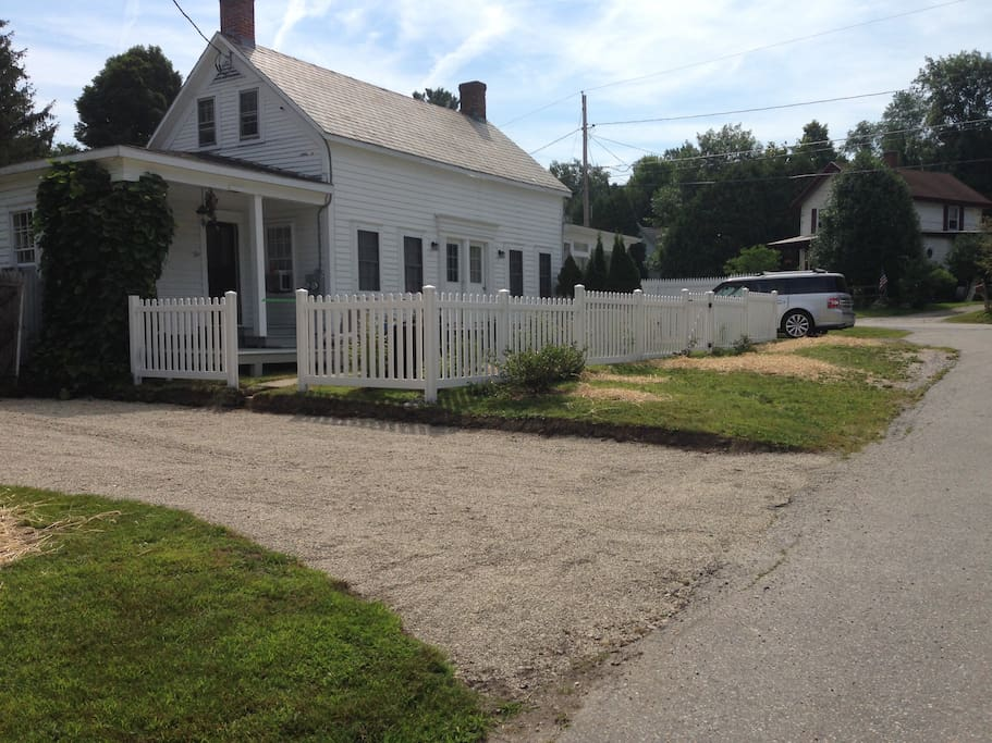 The In-Law Apartment in this 1850 Village Retreat has a private entrance at the far right of the house.