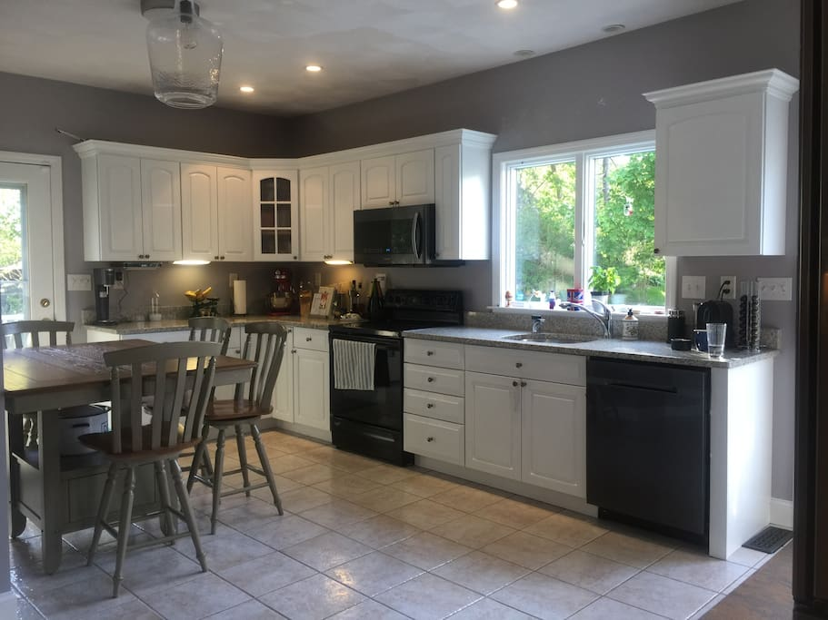 Recently renovated Kitchen includes Stove/Grill, combined over stove Microwave+grill, dishwasher, and fridge