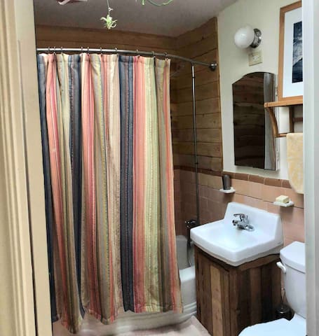 Your private bath up one flight of stairs with cedar-paneled shower
