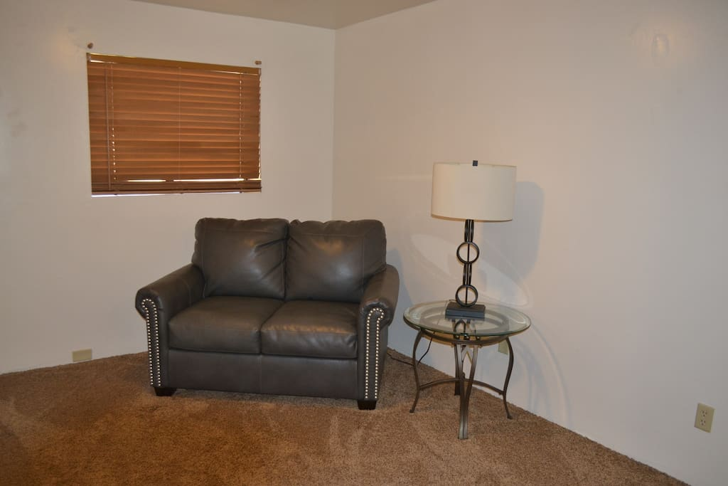 Sitting area in Master Bedroom.  Loveseat folds out into twin size bed.