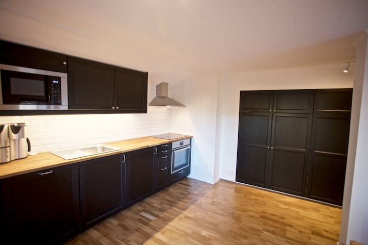 Newly renovated kitchen including dishwasher, microwave, coffee machine, waffle iron and more.
