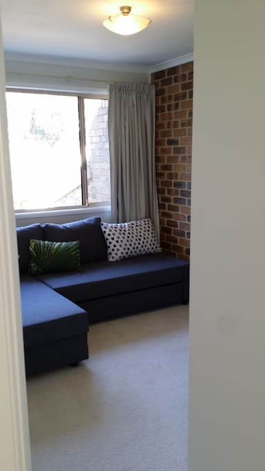 The sofa bed is easily retracted for sitting space during the day.