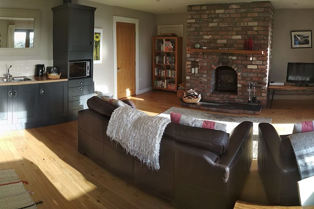 Spacious open plan apartment with fireplace, lounge area and double doors onto the private deck.