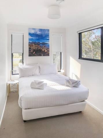 The second bedroom has a queen bed.