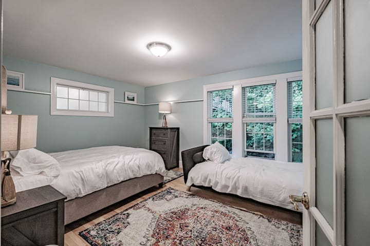 The bedroom off the living room has a queen bed and a day bed.