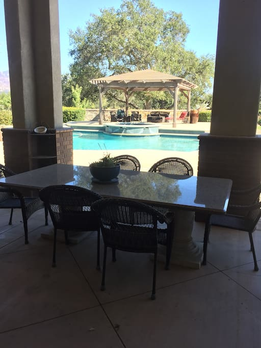 Covered patio dining table , right out side family room.