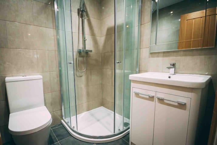 Full bathroom with power shower