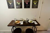 Kitchen table, perfect for 2 people to enjoy a meal and learn how to make your favorite martini.
