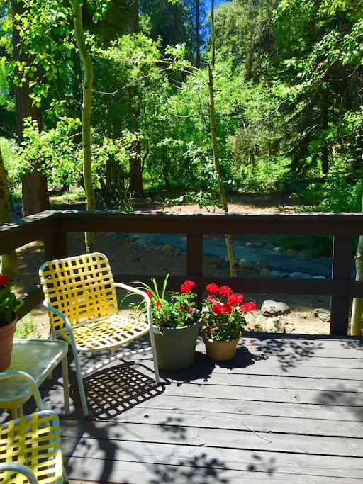 Comfortable deck with seating, this is the view from the front door.