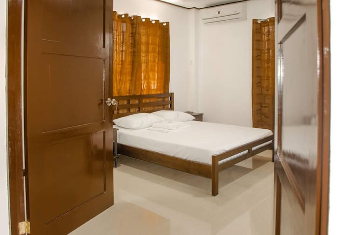 Air conditioned master bedroom with private bath and build in storage.