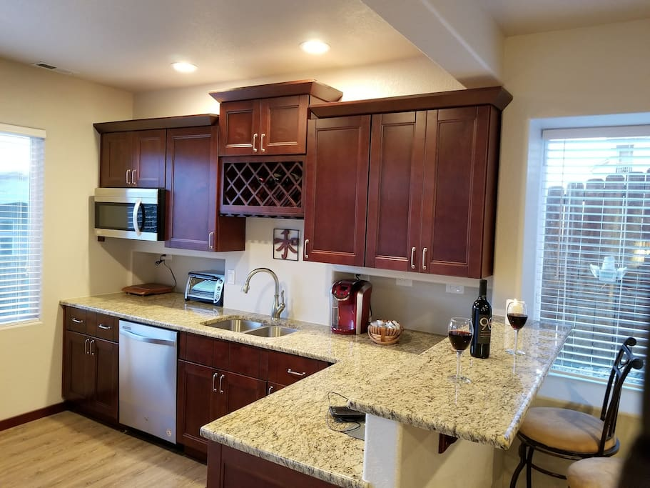 Kitchen-Like Wet Bar with: Microwave, Dishwasher Induction Hot Plate, Keurig Single Cup Coffee Maker.