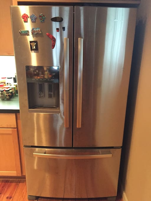 Stainless steel refrigerator with an ice machine and freezer. Food is not included
