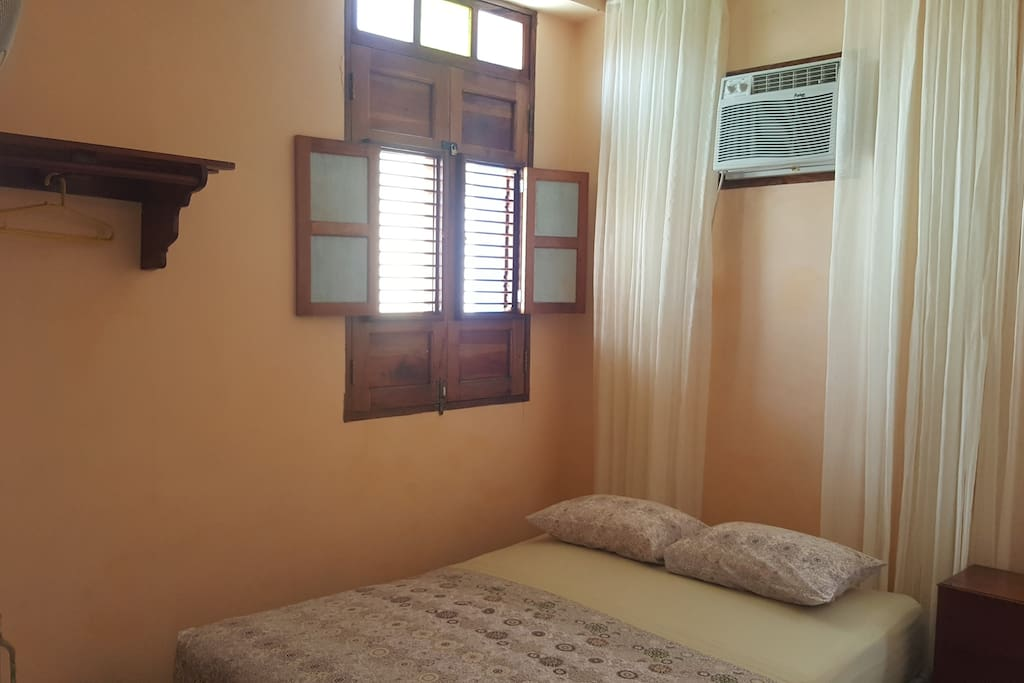 The cozy and spacius room has all the amenities you may need like big windows, air conditioner, fan, closet, clothes hangers and a comfortable and clean bathroom with hot water.