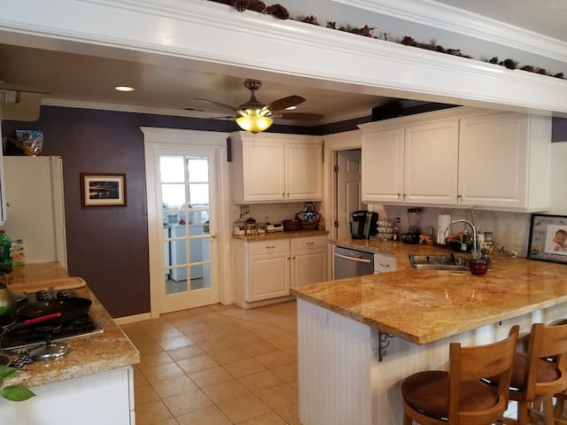 Open kitchen includes a Keurig with coffee and tea and fully stocked cupboards with pots/pans/dishes.