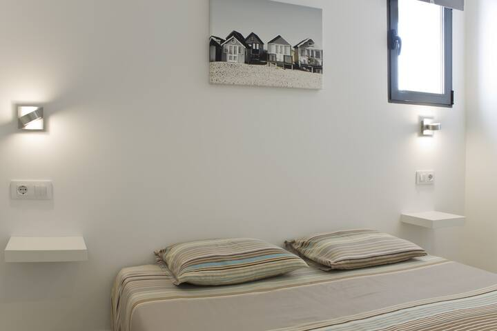Level 0: Bedroom 4 with double bed