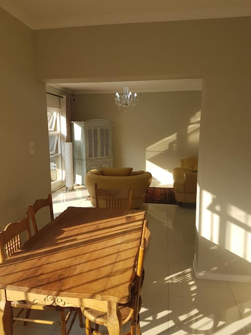 Bright Dinning area with separate kitchen, full fridge, microwave and necessary Kitchen utensils and equipment.