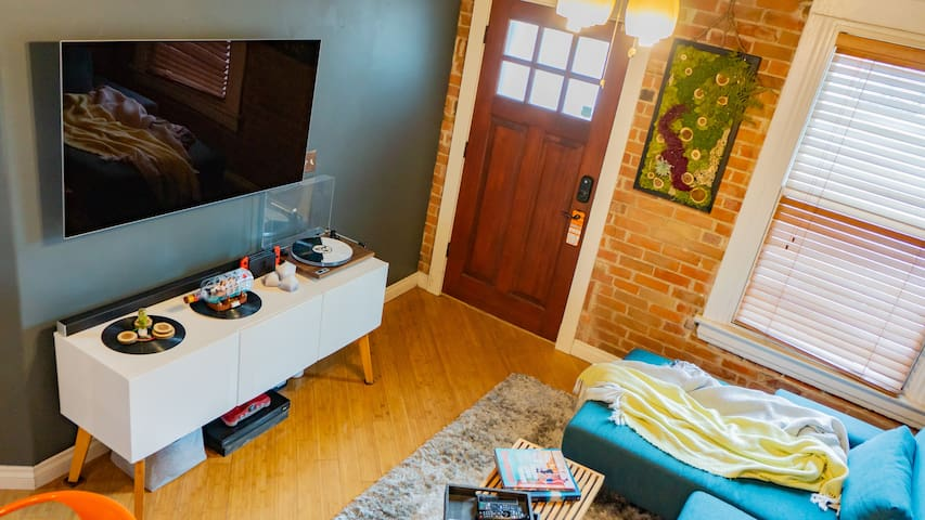 The living room boasts a 65-inch OLED tv which is great for viewing my extensive film collection or streaming Netflix.