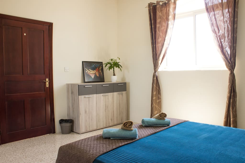 Bedroom with luxurious King-Sized Bed (160cm width) and Countryside View. Towels are provided.