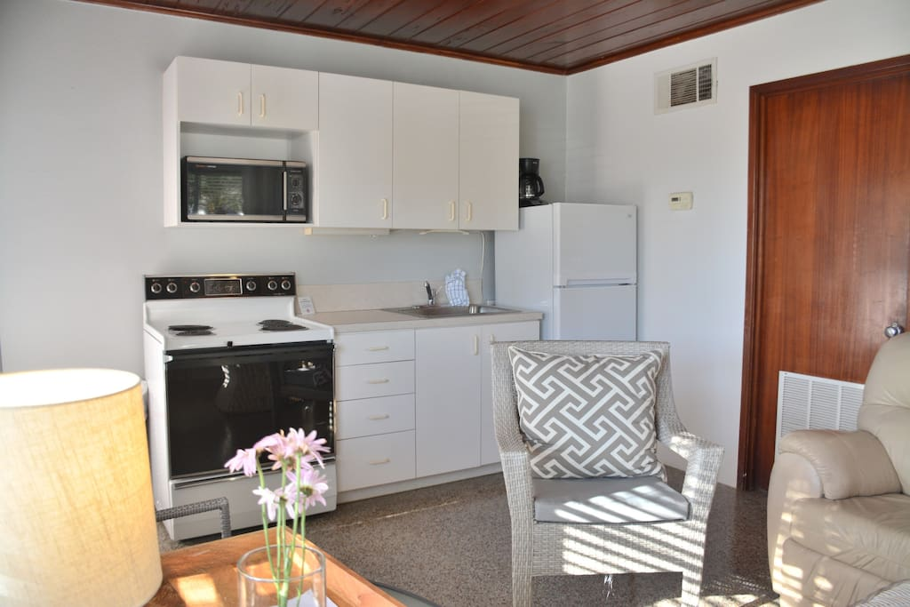 Enjoy a full kitchen, utensils, dishes, pots and pans, microwave, toaster and coffee pot.